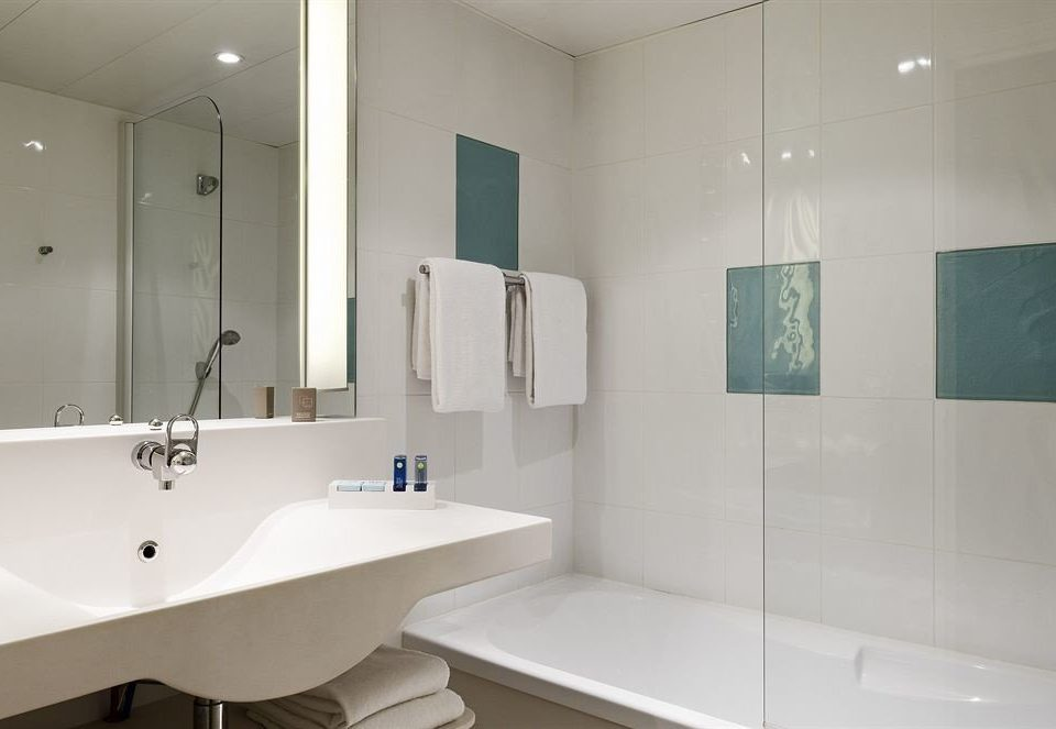 bathroom sink vessel mirror property bathtub white plumbing fixture bidet toilet water basin tile tiled
