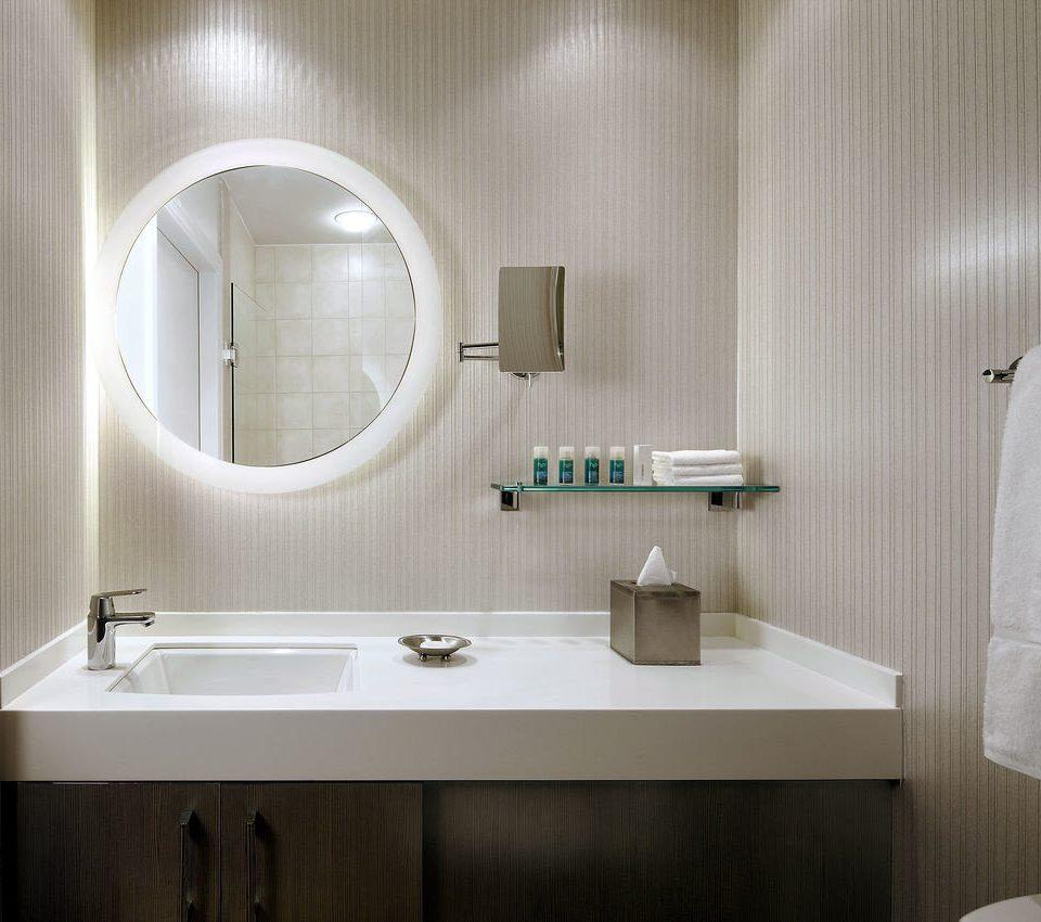 bathroom sink toilet mirror white plumbing fixture bathtub towel bidet