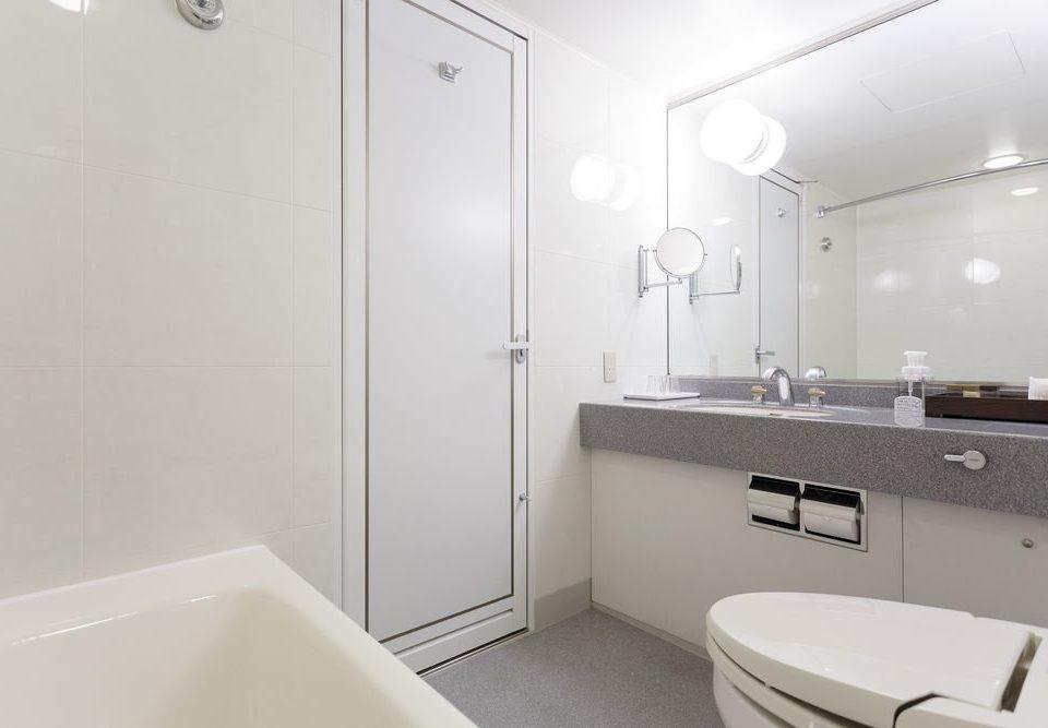 bathroom property plumbing fixture sink bathtub bidet toilet