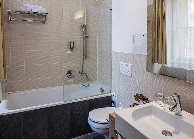 bathroom sink property vessel toilet plumbing fixture bidet water basin tile tiled bathtub