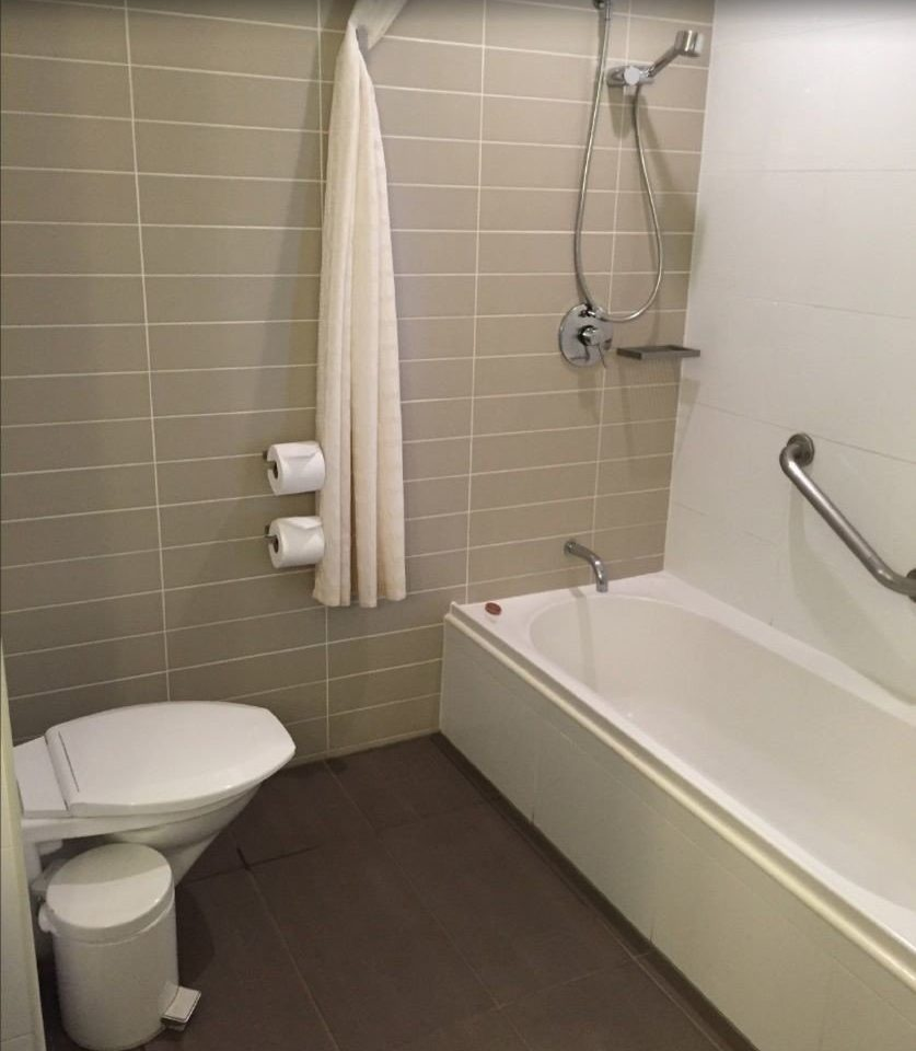 bathroom property sink toilet plumbing fixture bidet bathtub tile tiled