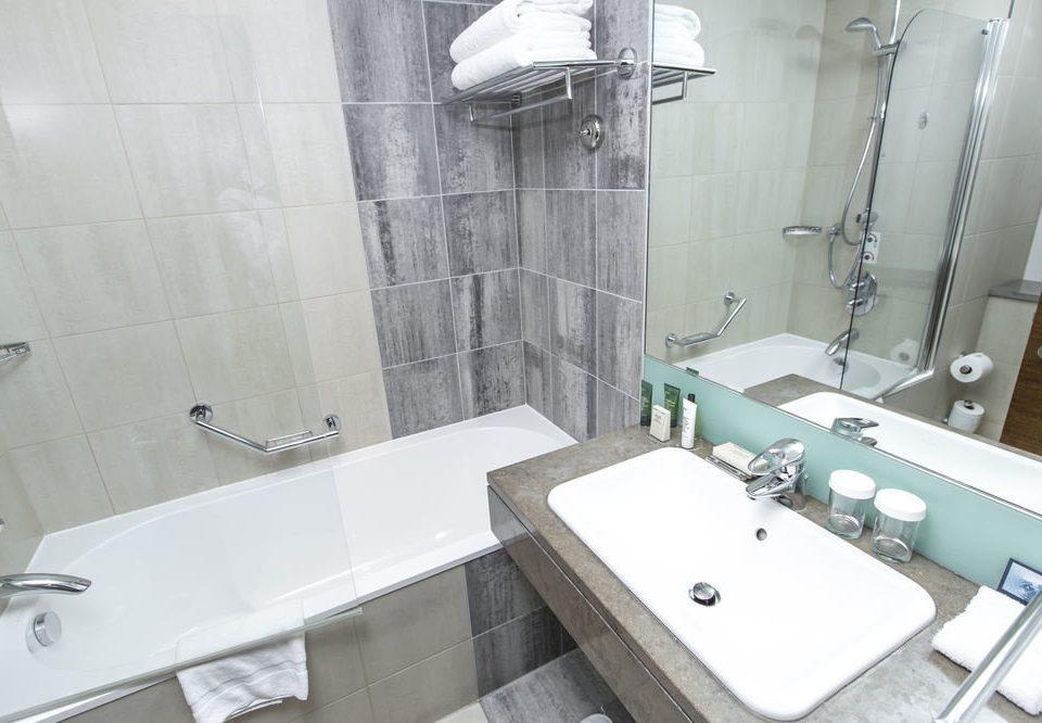 bathroom sink property toilet bathtub swimming pool plumbing fixture bidet vessel public toilet tiled tile water basin