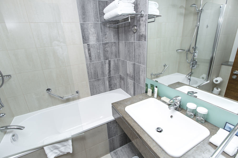 bathroom sink property toilet bathtub swimming pool plumbing fixture bidet vessel public toilet tiled tile water basin