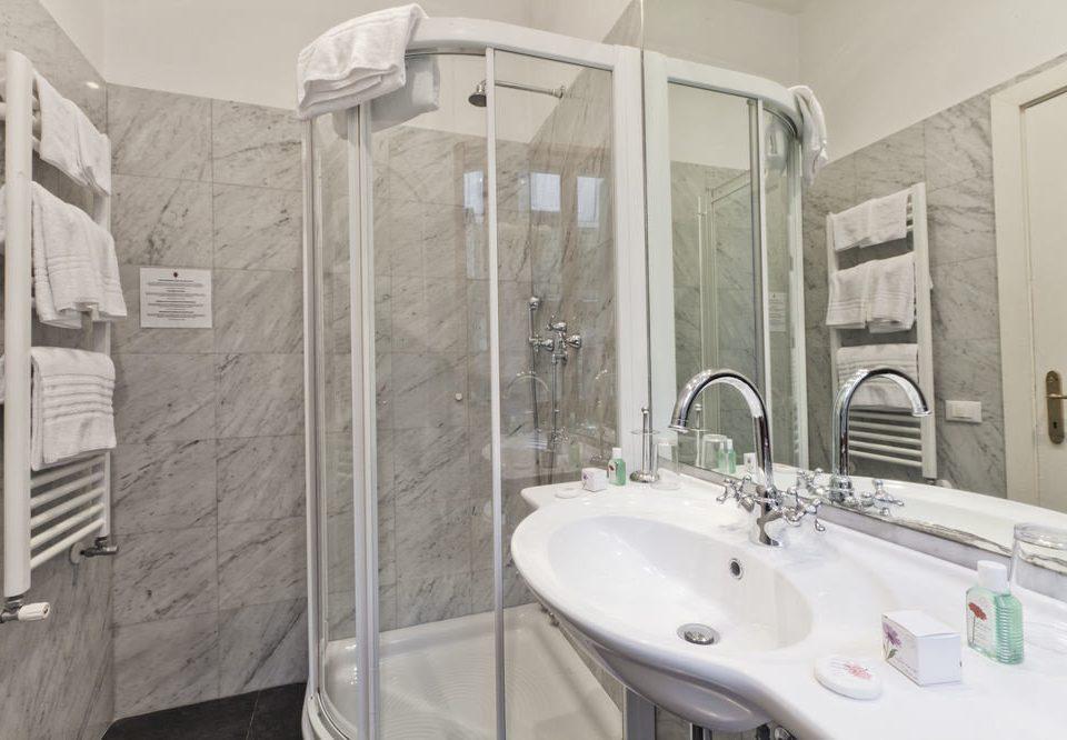 bathroom sink bathtub plumbing fixture toilet bidet public toilet swimming pool tile tiled