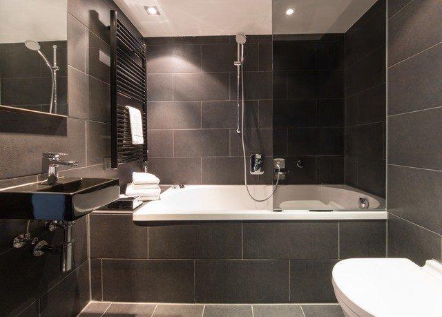 bathroom property sink toilet tiled plumbing fixture tile bathtub bidet