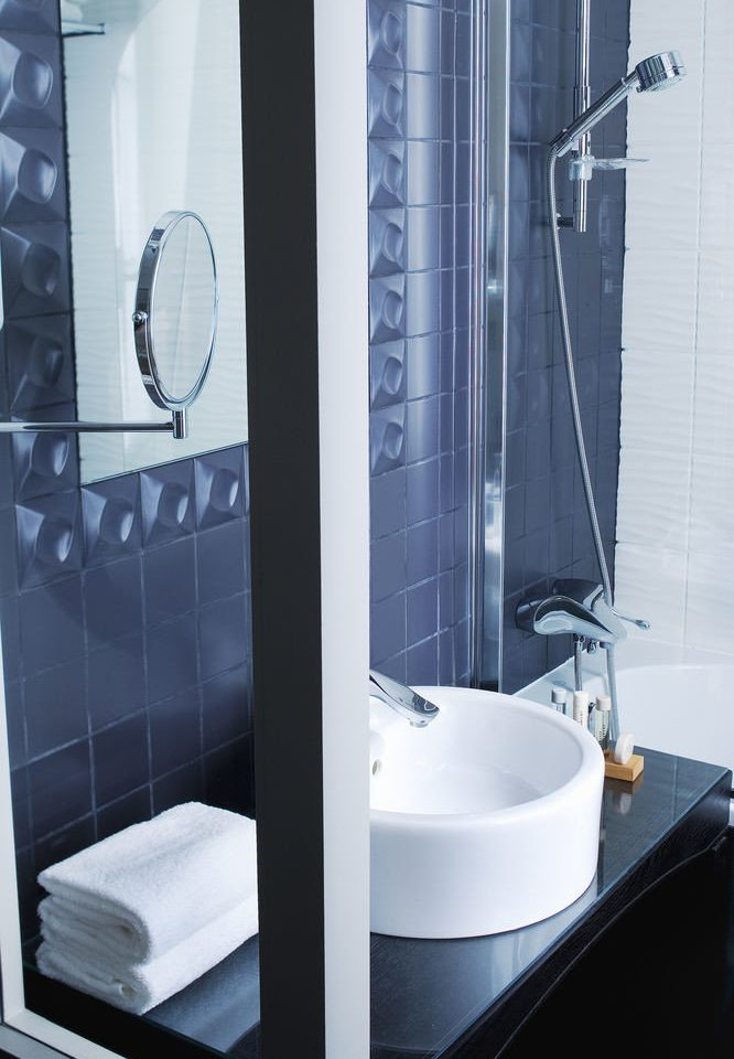 bathroom plumbing fixture bathtub bidet shower sink tap tiled tile