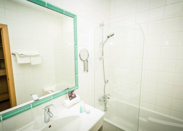 bathroom property toilet sink plumbing fixture bidet bathtub tile tiled