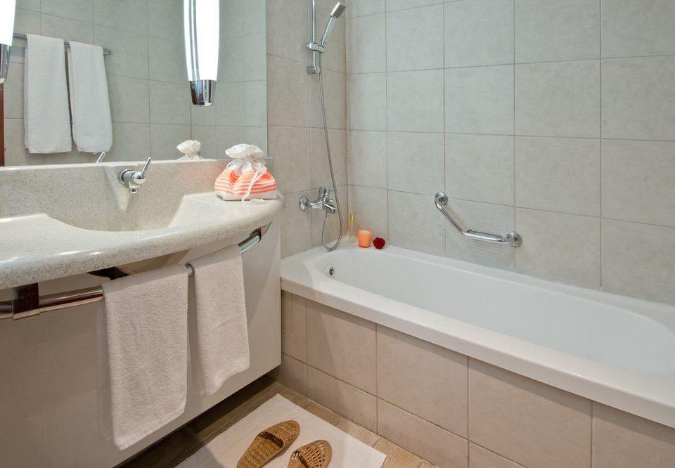 bathroom property vessel sink bidet plumbing fixture toilet bathtub tiled tile