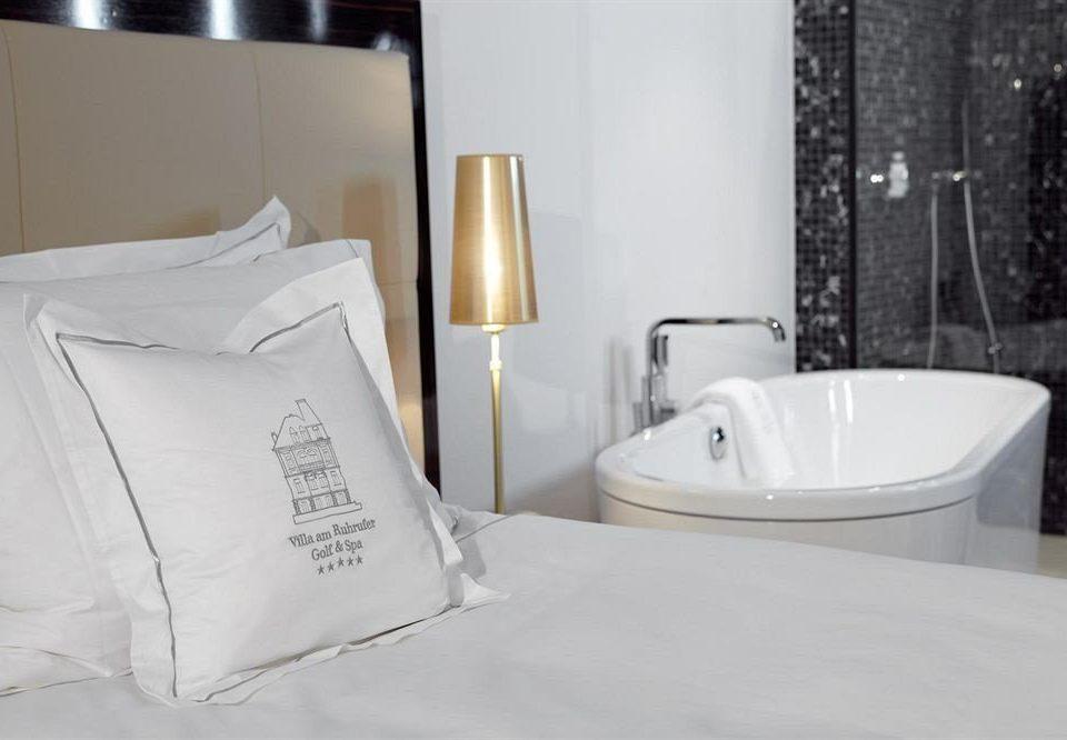 white bathtub bathroom plumbing fixture bidet sink