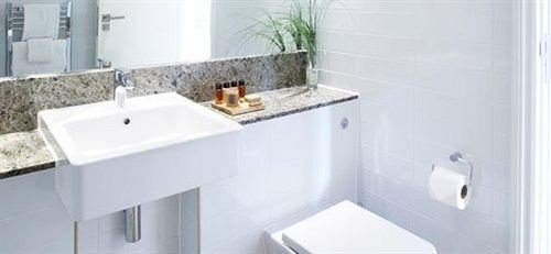 bathroom sink property bidet plumbing fixture toilet white bathtub vessel water basin tile