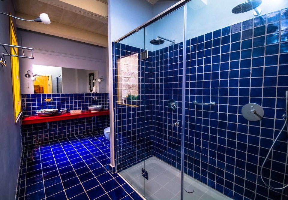 blue bathroom swimming pool tiled sport venue black tile toilet plumbing fixture tub bathtub