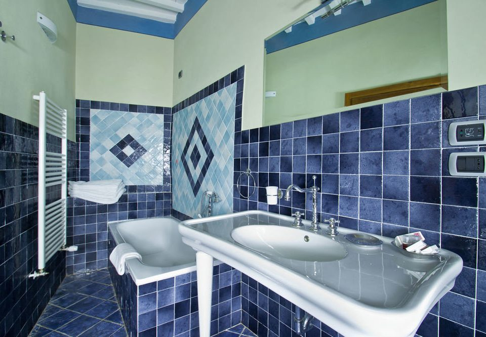 bathroom property tiled swimming pool sink black bathtub daylighting tile vessel flooring condominium blue toilet tub