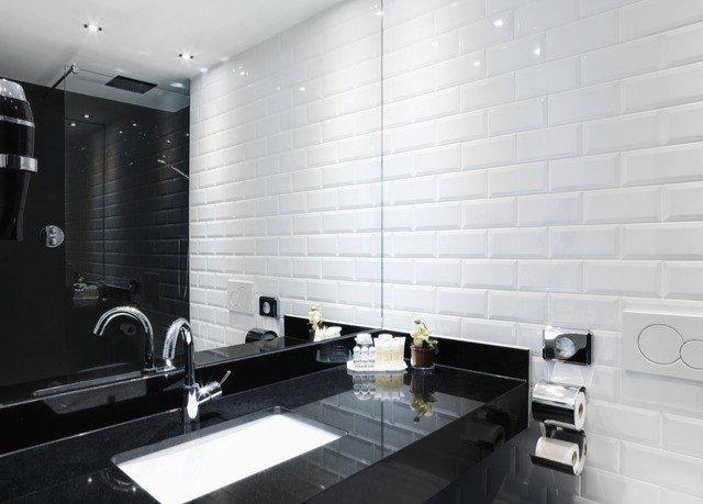 bathroom property sink black flooring tile lighting plumbing fixture living room bathtub toilet tiled
