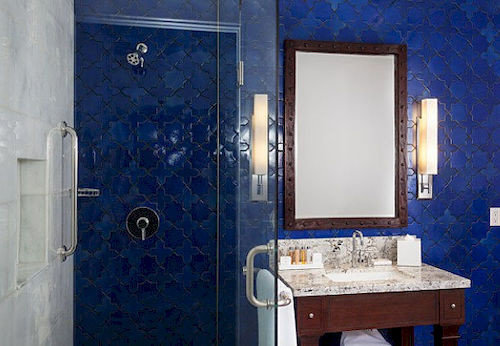 bathroom blue plumbing fixture sink public toilet flooring tiled tub tile bathtub