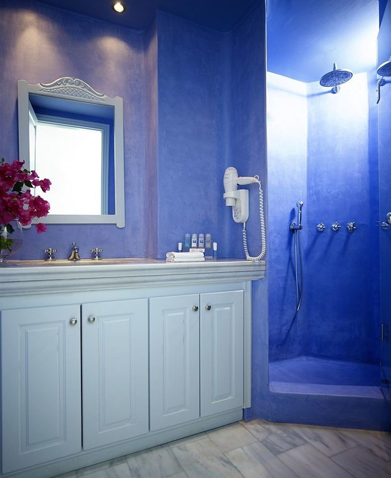 bathroom blue lighting plumbing fixture bathtub home sink light
