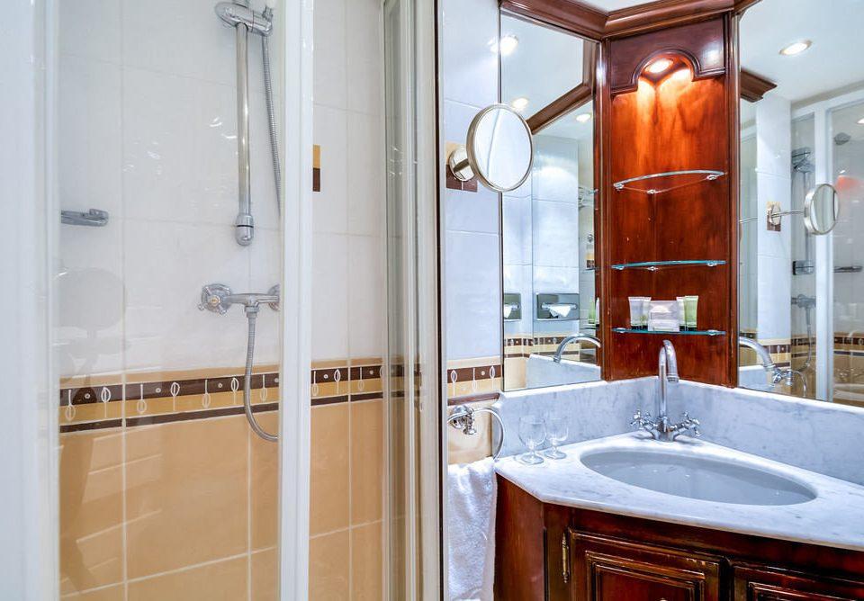 bathroom property home toilet vessel cabinetry sink cottage bathtub tile tiled