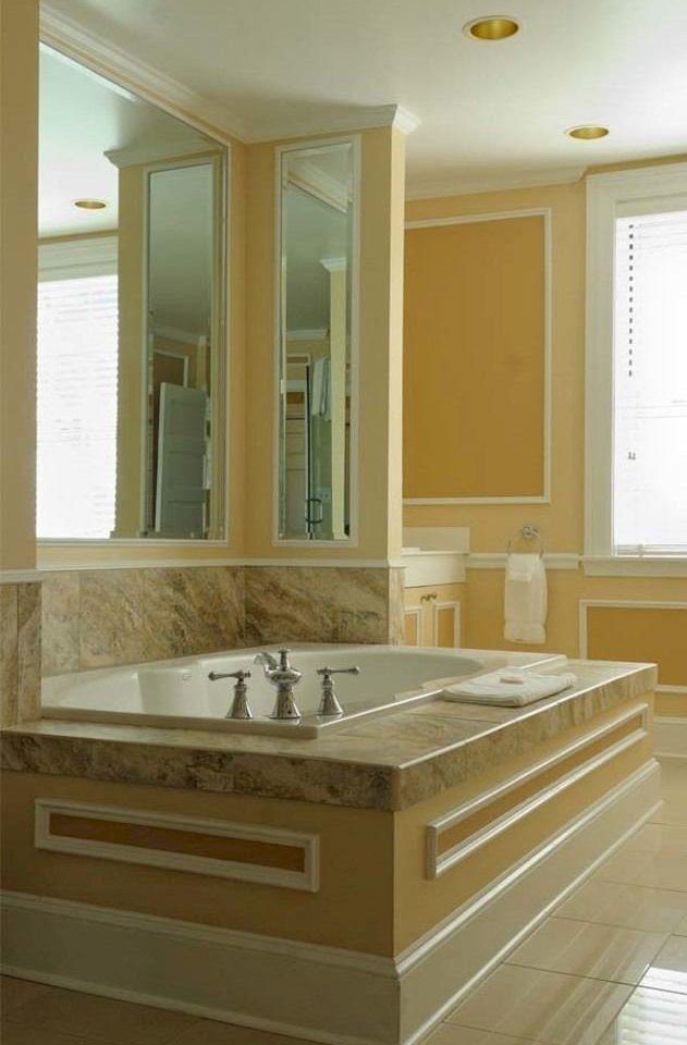 bathroom sink countertop cabinetry hardwood home plumbing fixture bathtub flooring molding tile