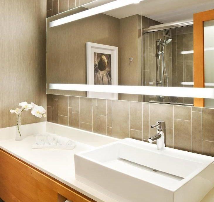 bathroom mirror sink plumbing fixture cabinetry countertop bathtub home flooring