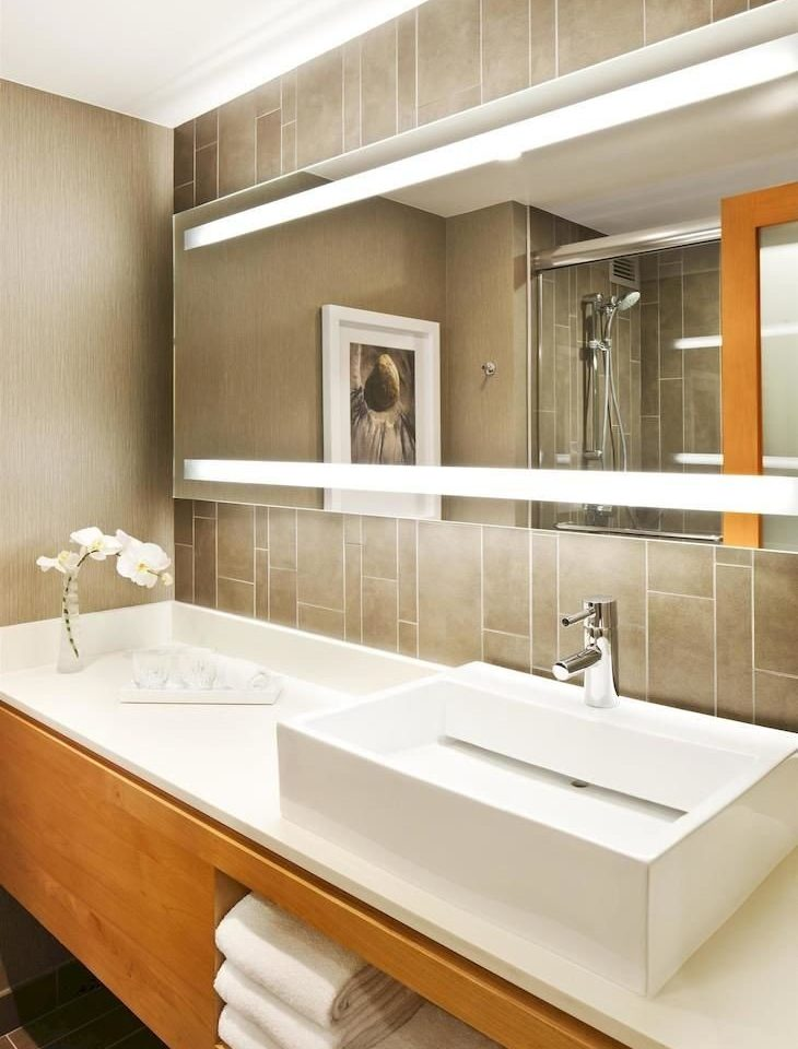 bathroom mirror sink plumbing fixture cabinetry countertop bathtub home flooring