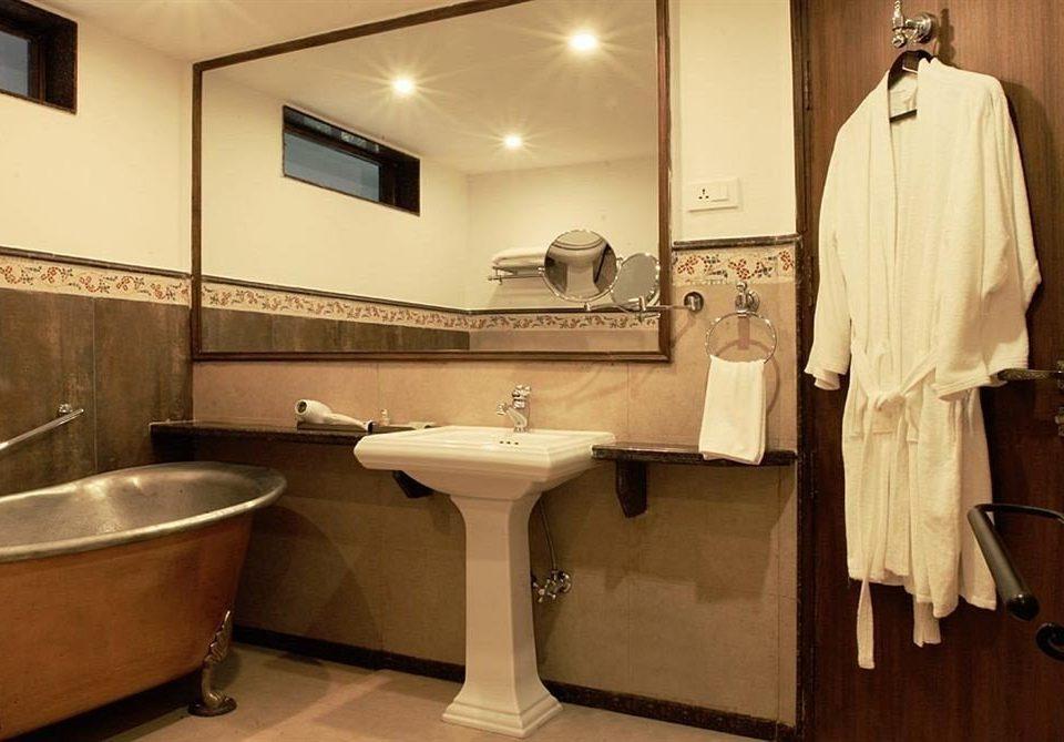 bathroom cabinetry sink home bathtub