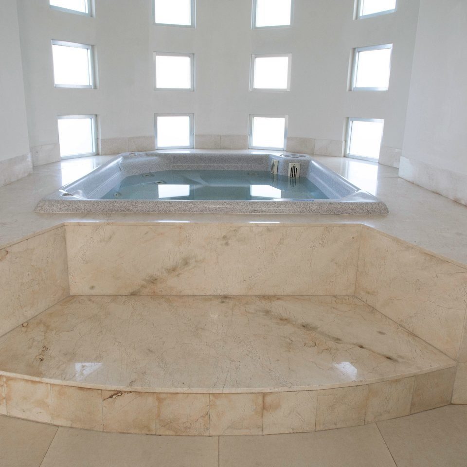 property swimming pool bathtub plumbing fixture bathroom jacuzzi flooring sink daylighting tile concrete cement water basin