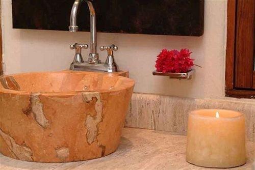 man made object sink plumbing fixture lighting bathtub vessel bathroom ceramic orange water basin