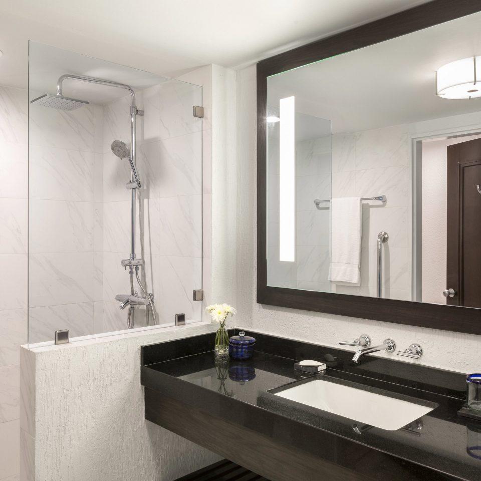 bathroom mirror sink property home plumbing fixture counter bathtub clean