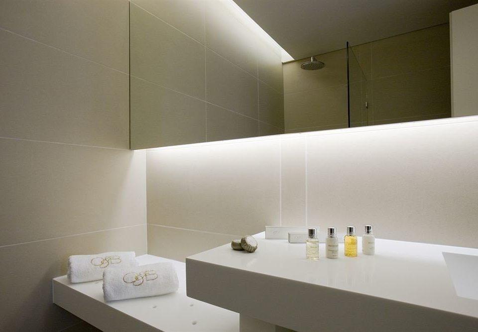 bathroom mirror sink counter lighting daylighting flooring bathtub clean