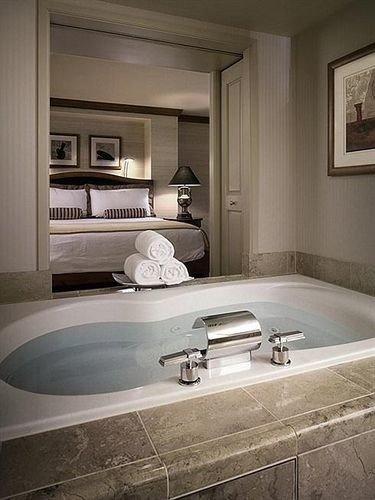 bathroom mirror sink countertop home flooring bathtub plumbing fixture tile clean