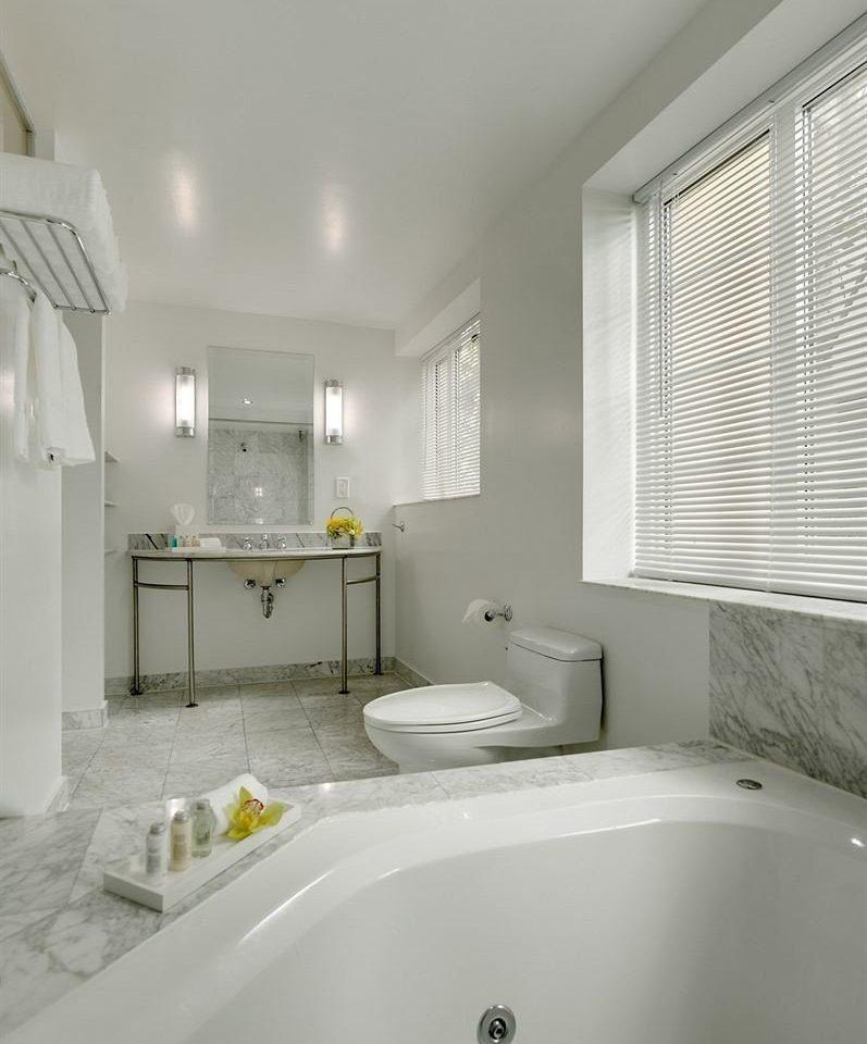 bathroom white sink mirror property vessel bathtub toilet home flooring clean