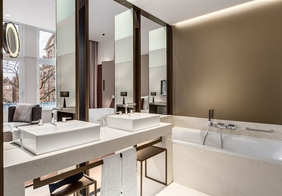bathroom mirror sink property home condominium tub bathtub square