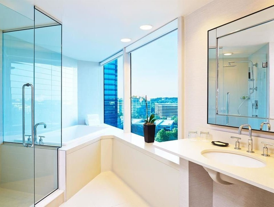 bathroom property mirror sink bathtub plumbing fixture condominium