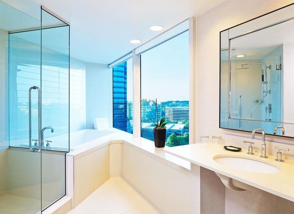 bathroom property mirror sink bathtub plumbing fixture condominium