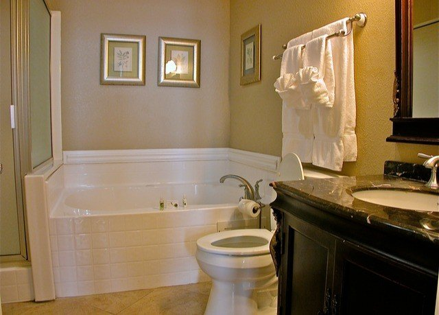 bathroom property home hardwood countertop cottage flooring tub kitchen appliance bathtub
