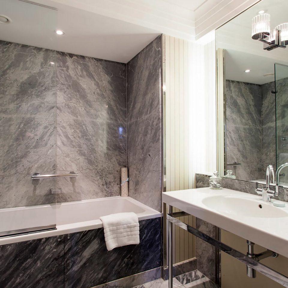 bathroom sink mirror property home countertop bathtub material plumbing fixture cottage tan tiled