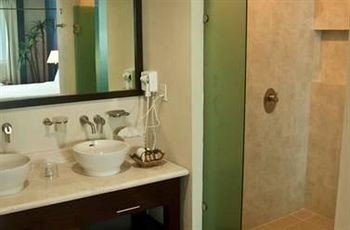 bathroom sink property mirror home cottage plumbing fixture flooring toilet tub bathtub