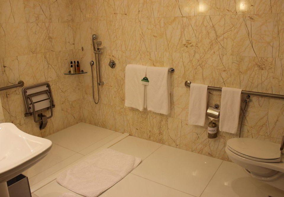 bathroom property toilet sink plumbing fixture flooring cottage bathtub tiled
