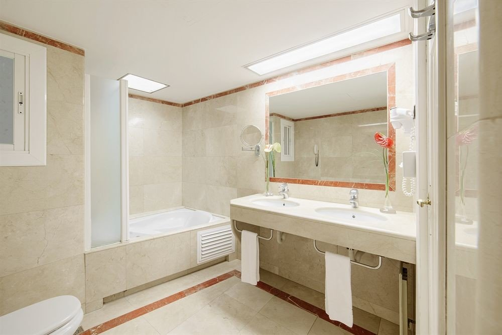 bathroom property house home sink cottage tub bathtub tiled