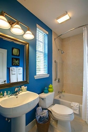 bathroom mirror sink property toilet home white cottage tub bathtub