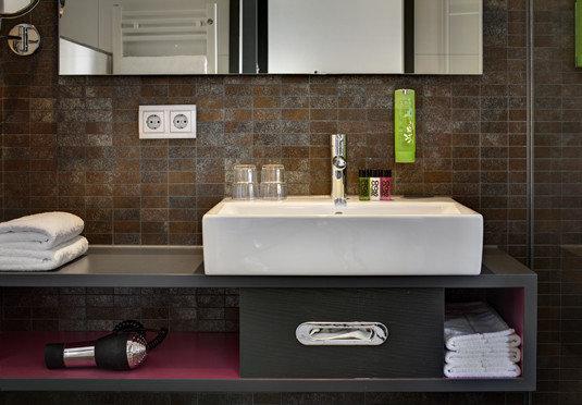 bathroom mirror sink countertop plumbing fixture bathtub home flooring tile counter