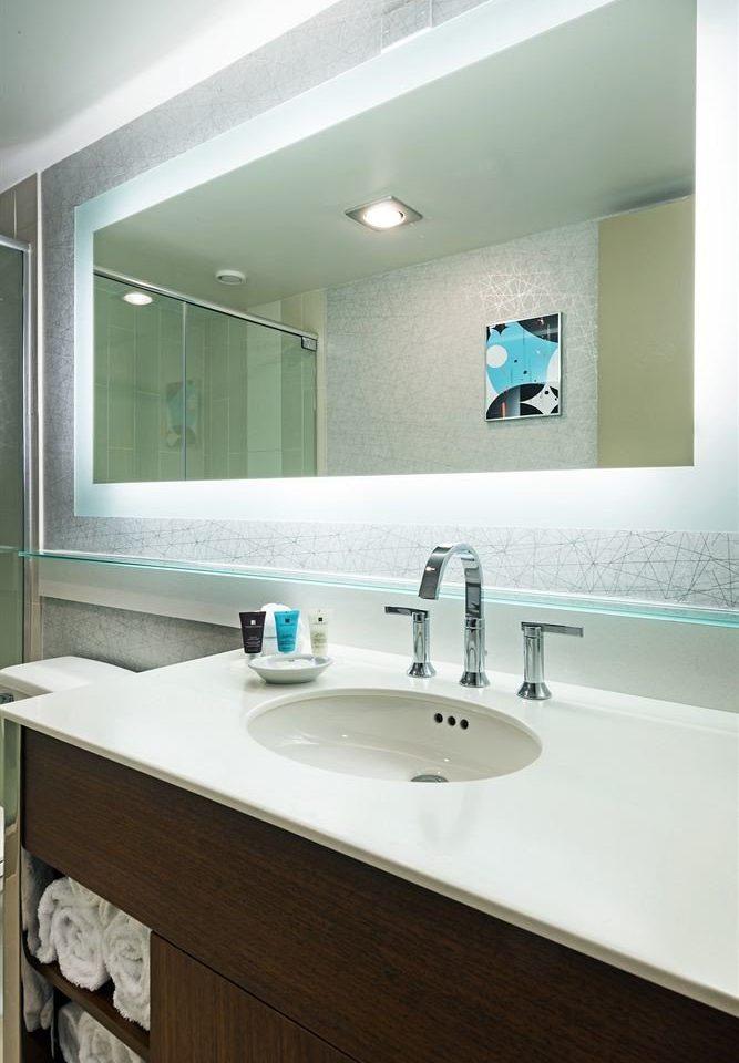 bathroom sink mirror property vessel home counter countertop flooring plumbing fixture bathtub