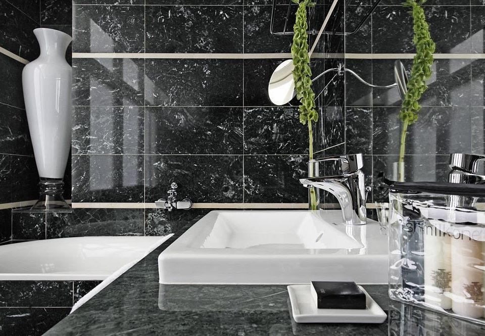 white bathroom plumbing fixture sink bathtub countertop tile flooring material glass toilet