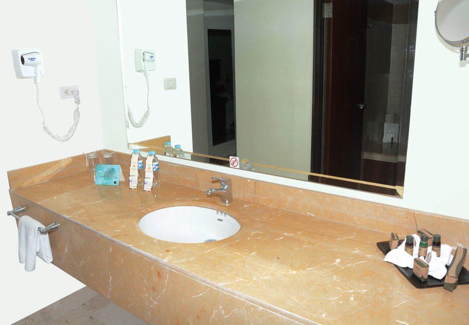 bathroom sink property countertop plumbing fixture toilet bathtub flooring