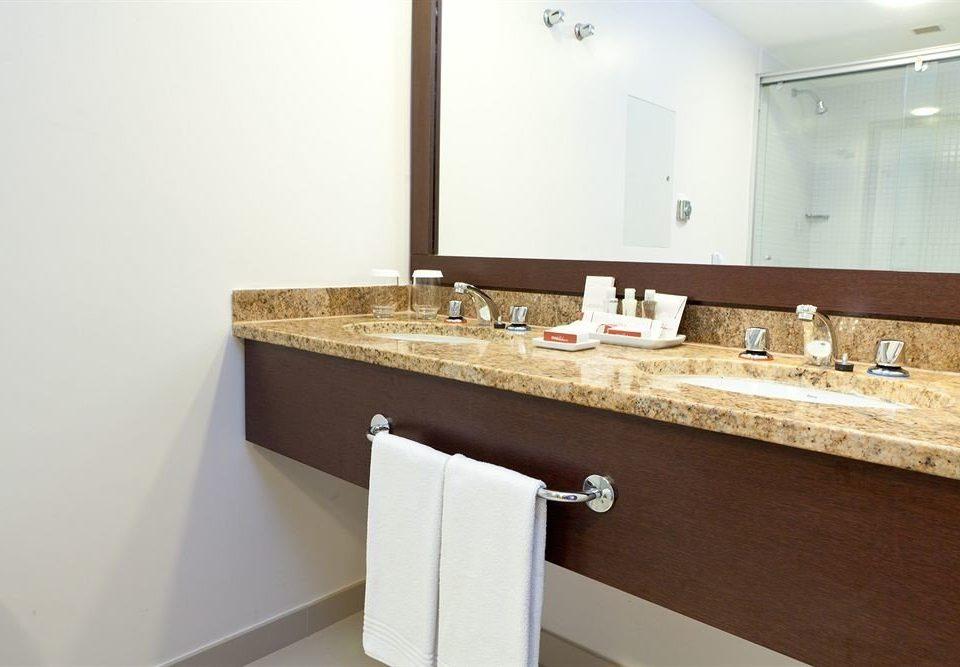 bathroom mirror sink property bathtub plumbing fixture countertop flooring