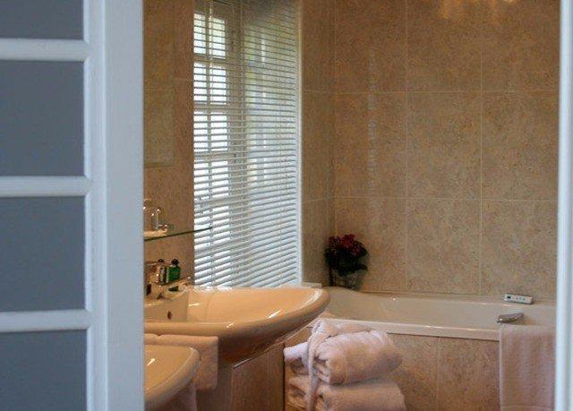 bathroom property window treatment curtain tub bathtub