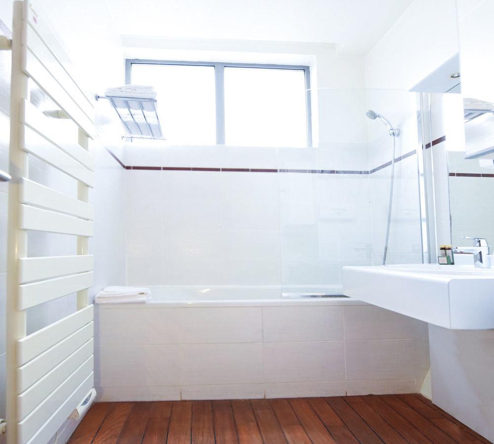 property white bathtub bathroom plumbing fixture daylighting flooring tub tile tiled