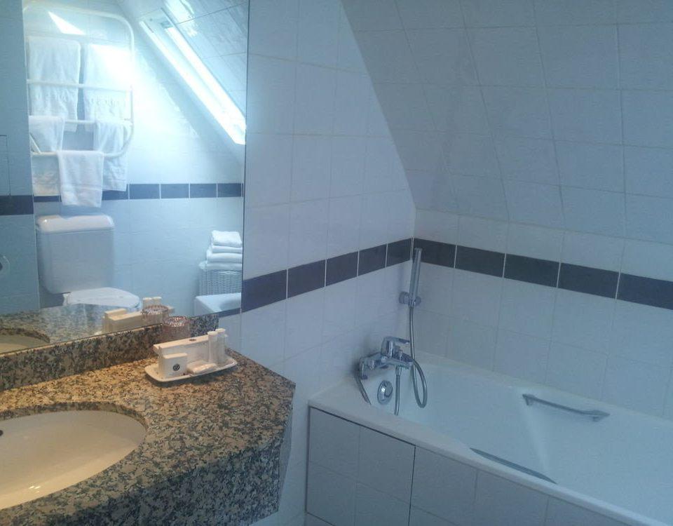 property bathroom swimming pool flooring sink daylighting toilet tile bathtub tiled