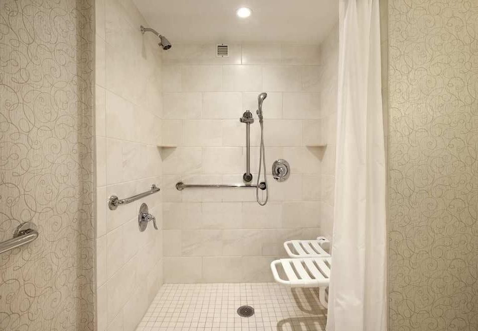 bathroom scene property white toilet house plumbing fixture home shower flooring tile tiled bathtub dirty