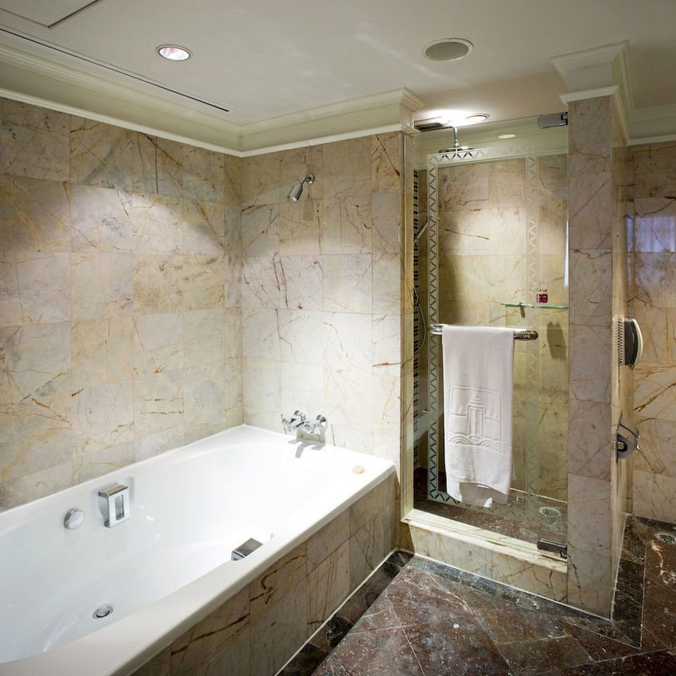 bathroom property plumbing fixture vessel public toilet bathtub home flooring swimming pool tub dirty tiled