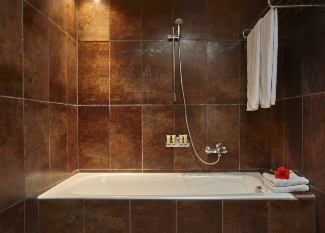 bathroom plumbing fixture scene bathtub flooring hardwood tile tiled